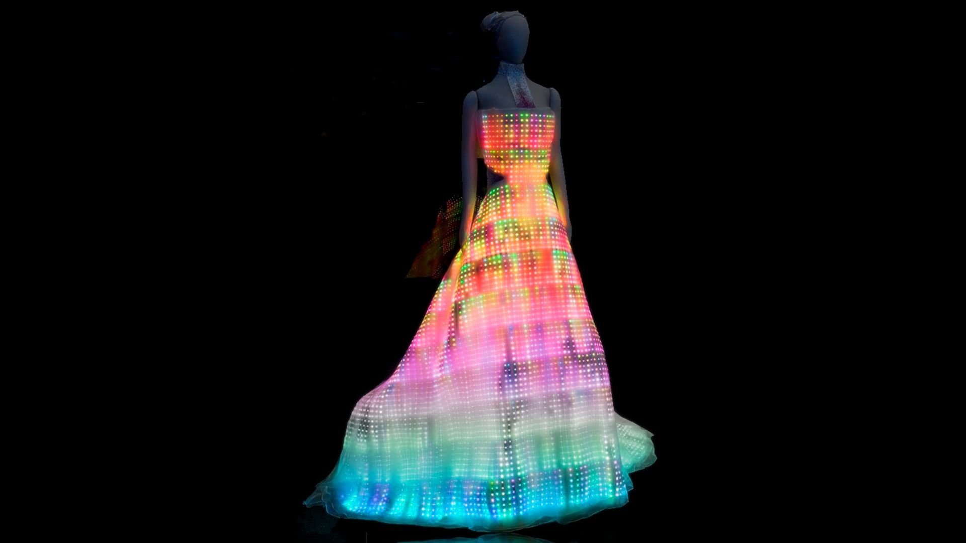 The Galaxy Dress was commissioned by the Museum of Science and Industry in Chicago as the centerpiece for the exhibition Fast Forward: Inventing the Future, and is now part of the museum's permanent collection. Embroidered with 24,000 color LEDs, the smart-tech evening gown is the world's largest wearable display. The tiny LEDs are as thin as paper and measure just 2 x 2 mm.