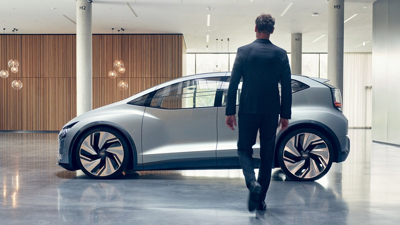 Man approaching concept car AI:ME in a foyer.