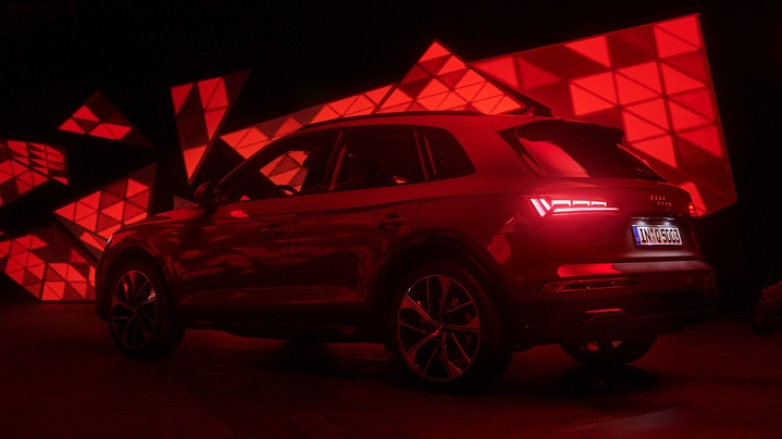 Audi Q5 SUV amidst an abstract light installation.