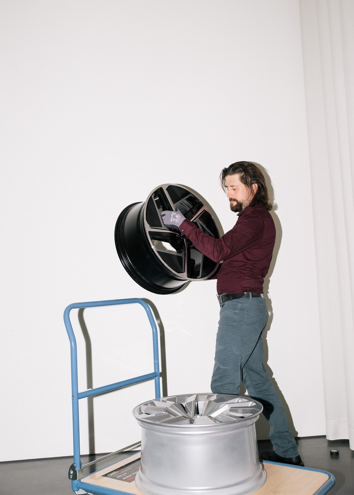 Andreas Valencia Pollex lifts the aero wheel from a trolley.